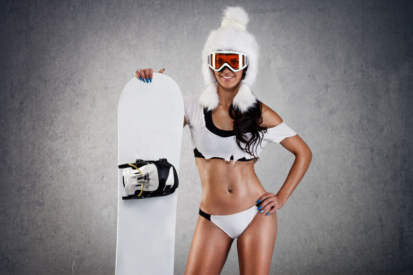 セクシーな若いメスのスノーボーダー