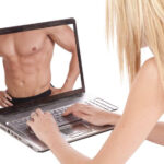 8623940 - a woman is using her laptop and looking at the chest of a man.