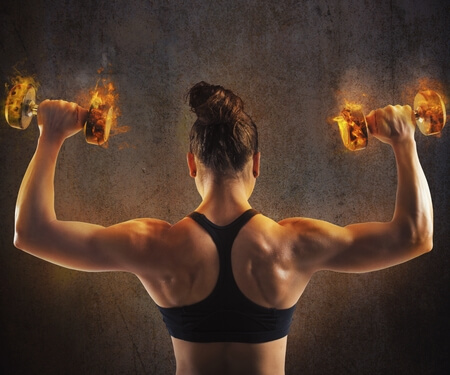 42119676 - gym woman train back with fiery dumbbells